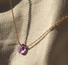 """Rich amethyst solitaire is stationary on this necklace, with the cabochon smooth briolet being the focal point and beaming a deep purple color.  This necklace, 16"""", in lightweight and easy to wear everyday for the person on the go!  Delicate but sturdy, it is a lovely shade of purple on gold filled chain. More photos to follow! Cute Jewelry, Jewelry Box, Jewelery, Jewelry Accessories, Jewelry Necklaces, Fashion Necklace, Fashion Jewelry, Crystal Aesthetic, Accesorios Casual"""