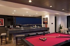 The New American Home 2013, built by Blue Heron, has a dazzling view behind the bar of the skyline near Las Vegas.