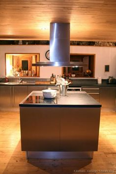 #Kitchen Idea of the Day: Modern stainless steel kitchens. Beautiful wood plank ceiling