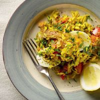 Smoked Mackerel Kedgeree. Amazingly simple, works with garam masala instead of curry powder (and without egg). Some turmeric could add some nice colour.