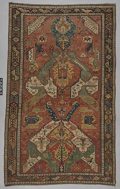Dragon design  Object Name:     Carpet Date:     early 19th century Geography:     Azerbaijan, probably Kuba Medium:     Wool (warp, weft and pile) Dimensions:     Textile: L. 120 in. (304.8 cm) W. 74 in. (188 cm) Classification:     Textiles-Rugs