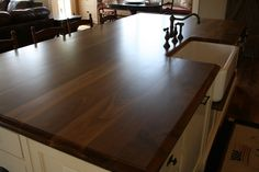 OMG! I'm in love with this countertop: wide plank walnut finished with waterlox