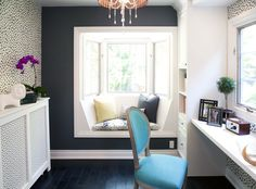 Love this little reading nook, accent wallpaper and moody dark wall color.