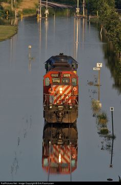 Due to high water from the flooding Mississippi River, the Canadian Pacific decided not to detour but instead push/pull trains through the high extensions of the surface that lapped its wheels. Rail Train, Train Art, Train Tracks, Train Rides, Diesel Locomotive, Steam Locomotive, Canadian Pacific Railway, Railroad Pictures, Abandoned Train