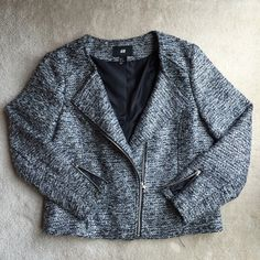 H&M silver and black boucle moto jacket H&M silver and black boucle material moto jacket with zips. Collarless style with zips along sleeves. Worn once and in new condition. U.S. Size 12. H&M Jackets & Coats