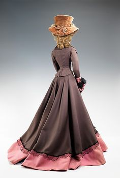 """1787 Doll""  Mendel   Designer: Rose Valois (French) Designer: René Rambaud Date: 1949 Culture: French Medium: metal, plaster, hair, wool, fur, silk Dimensions: 28 x 16 in. (71.1 x 40.6 cm) Credit Line: Brooklyn Museum Costume Collection at The Metropolitan Museum of Art, Gift of the Brooklyn Museum, 2009; Gift of Syndicat de la Couture de Paris, 1949 Accession Number: 2009.300.721a–c"