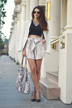 Obsessed with this outift!   Crop Top + Statement Necklace + High Waisted Shorts + Snakeskin Bag