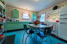 Gorgeous 1940s style kitchen built new -- aqua steel cabinets, vintage dinette, Big Chill refrigerator, Bradbury wallpaper