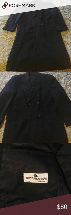 """Christian Aujard double breasted wool coat Dark grey almost black wool coat made in Hungary by Paris designer Christian Aujard. In perfect condition. Front pockets as well as three good sized pockets in the lining. Three buttons on cuff and lined in black satin. Split up the back from bottom hem to midway. Coat measures in length at 48"""". Across back at shoulders measures 20"""" and sleeve length is 26"""". Very classy coat for the man in your life. Perfect for the Holiday festivities. Christian…"""