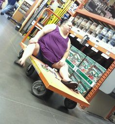 Improvised Scooter - Home Depot Cart Beats Walmart Scooter - Funny Pictures at Walmart