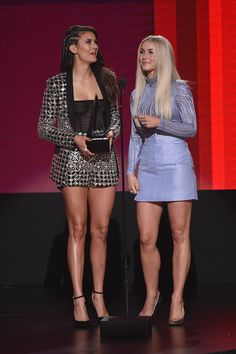 Julianne Hough Photos Photos - Actresses Nina Dobrev (L) and Julianne Hough speak onstage during the 2016 American Music Awards at Microsoft Theater on November 20, 2016 in Los Angeles, California. - 2016 American Music Awards - Show