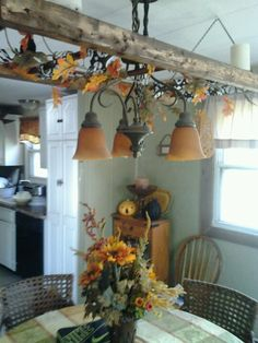 Love the ladder in the kitchen idea... could hang decorations from it during holidays, and use it as a pot holder! <3