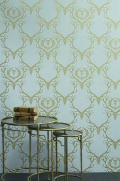 Quirky wallpaper design featuring an all over damask design, made up of deer skulls and antlers.