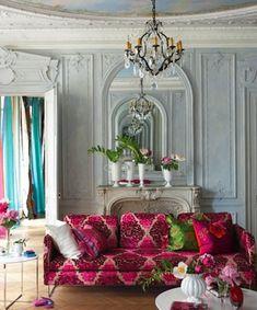 fuchsia sofa gray walls