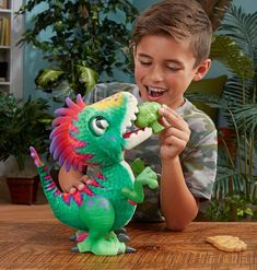 A broccoli-eating dinosaur called Munchin' Rex. Munchin' Rex is a baby dinosaur that seeks attention by hopping when it is hungry. To satisfy the dinosaur toy's hunger, kids are able to feed Munchin' Rex either a plastic piece of broccoli or a caveman cookie, both of which will trigger fun responses from the plaything, sometimes, the dinosaur toy will make spitting, slurping or burping sounds, depending on its mood.  Responds to both sound and touch.