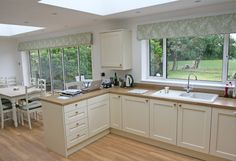 ideas kitchen window dressing ideas roman blinds dining rooms for 2019 Kitchen Doors, Curtains With Blinds, Kitchen Window Dressing, Sliding Door Blinds, Bifold Doors, Blinds For Bifold Doors, Roman Blinds, Roman Blinds Kitchen, Blinds