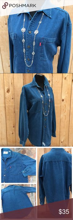 """🆕 Unisex Levi's Chambray Denim Shirt Levi's chambray blue denim, metal button up, long sleeve shirt. Sleeve cuffs have one metal button. Shirt has two front pockets. Content is 100% Cotton. Measures 25.5"""" pit to pit & 29"""" long. In great preloved condition with NO holes. Tag is Mens L. Levi's Shirts Casual Button Down Shirts"""