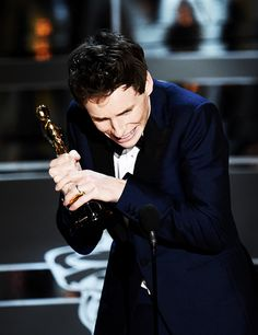 Eddie Redmayne accepts his award on stage at the 87th Oscars February 22, 2015 in Hollywood, California