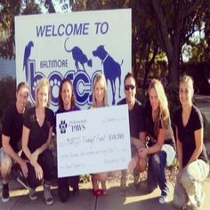 Professionals For Paws present the Pawject Runway check to BARCS