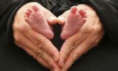 Baby feet in grown up hands heart.love me some baby feet.