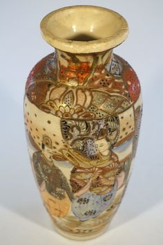 Handmade vase with hand painted Satsuma design. Based on research and comparables, this appears to date back to the Meiji period in Japan (1868 - 1912). Looking inside this earthenware vase reveals th