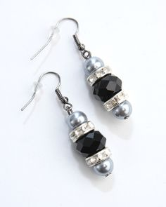 Vi Bella Jewelry - Midnight Earrings - A night out? A night in? Do both in style! The Midnight Earrings consist of multifaceted black beads, bejeweled silver beads, and grey pearls. Wear with the Midnight necklace and Midnight Bracelet, or with the beautiful Twilight Necklace.  Perfect!     Length - 1.75 Inches     Handcrafted by Vi Bella Artists in Haiti.  $16.95