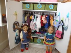 American girl doll closet, I made this for my daughters doll clothes, it was fast and inexpensive to make. The storage unit I purchased from Target, I put a tension rod in to hang the clothes. And the boxes I purchased at Micheal's along with the the mirror and hooks. The best thing of all it holds a tun of stuff.