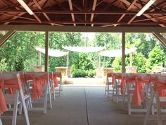 Coral sashes for the outdoor ceremony in the Gardens at Sand Springs