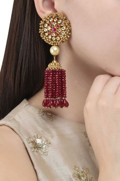 ANJALI JAIN Gold Finish Polki and Ruby Stone Tassel Earrings #anjalijain #gold #polki #ruby #stone #tassel #earrings Indian Jewelry Earrings, Jewelry Design Earrings, Indian Wedding Jewelry, Ruby Jewelry, Antique Earrings, Gold Jewelry, Jewelery, Jewelry Accessories, Diamond Jewelry