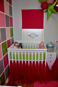 This #colorblock accent wall makes a huge impact in this small nursery.