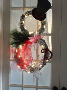Learn how to make your own DIY snowman wreath to decorate the front door to your home for winter!