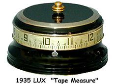 """Clock - 1935 Lux """"Tape Measure """" Mystery rotary clock. The clock came in a variety of different colors. It is a thirty hour wind up clock. Invented by Herman F. Lux and manufactured by the Lux Manufacturing Co.;Inc. in Waterbury Conn."""