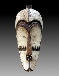 """Africa   """"Ngil"""" mask from the Fang people of Gabon, Cameroon, Equatorial Guinea   Wood, pigments and kaolin."""