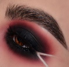 For a night out where drama and sophistication are the watchword, a smoky eye look could be just the thing. It doesn't take a makeup artist to do this, either; here's how to create smoky eyes with the makeup most people have at home. Red And Black Eye Makeup, Black Smokey Eye Makeup, Red Eyeliner, Black Makeup, Glam Makeup Look, Crazy Makeup, Goth Makeup, Skin Makeup, Red Smokey Eye