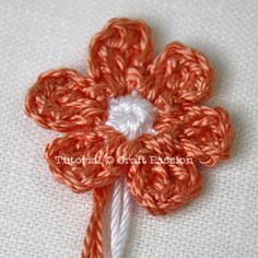 Flower Crochet pattern: {white} Begin with a sl knot of approx 3″ – 4″ tail. r1 – ch2, sc6 on 2nd st from hook, slst to the first ch to make a ring. {orange pink} Insert the hook at the last st of r1, yarn over to make a loop as the beginning st of r2. r2 – *slst on next st, ch3, dc, ch3, slst, repeat * 6 times to make 6 petals. fo & leave approx. 3″ – 4″ tail