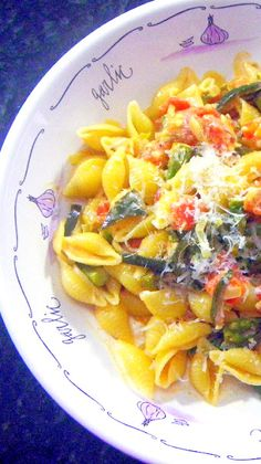 Pasta and Asparagus with a Creamy Tomato Vodka Sauce... Get out of the habit of a tomato sauce... This classic cream sauce is so easy to make and perfect for meatless Monday meals!