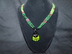Shopping necklace in greens black and red with purse pendant  http://www.artfire.com/ext/shop/product_view/Lil_Panther_Creations/4786768/Shopping_necklace_in_greens_black_and_red_with_purse_pendant/Jewelry/Necklaces/Beadwork#