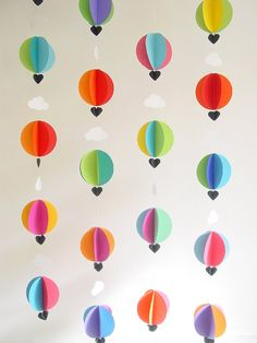 GarlandHot Air Balloons & Clouds3DCrib by youngheartslove on Etsy  hanging down underneath pergola with white paper pom poms