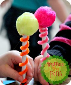 made some like these for our Dr. Seuss Literacy Night, but I made pom poms out of cool yarn and put them on top of pencils -- so cute!!