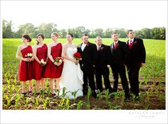 white dress. black suits. red bridesmaids. one change = cowboy boots.