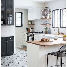 A patterned floor gets us every time. Loving this fun & fresh kitchen by @witanddelight_. | Via Instagram: @scoutandnimble