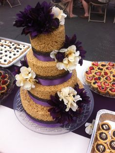 """A rice krispie wedding cake made by one of our very own employees using our 4"""" deep round pans!"""