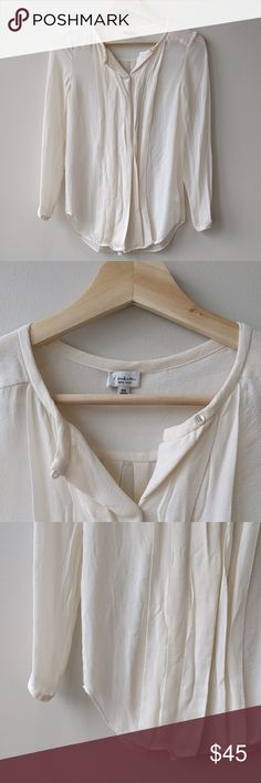 Aritzia Babaton Sz XXS Silk Cream Blouse Aritzia Babaton Sz XXS Silk Cream Blouse Long Sleeve  All measurements are done with the garment laying flat on a table and measured straight across.  Size: XXS Color: Cream Armpit to armpit: 16 inches Sleeve (mid back to end of sleeve): 27 inches Length (shoulder to bottom hem): 26 inches  Feel free to ask questions! I want to make sure you're getting what you want :)  Like what you see? Check out my other listings! Aritzia Tops Blouses