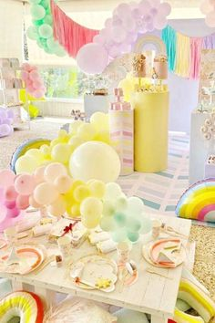 Feast your eyes on this magical rainbow birthday party! The table settings will blow you away! See more parties ideas and share yours at CatchMyParty.com #catchmyparty #partyideas #rainbow #rainbowparty #girlbirthdayparty