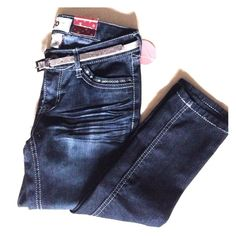 Blue skinny jeans. Embellishment on pockets. Both front and back. Comes with silver belt. Brand new. Never worn. SO Pants