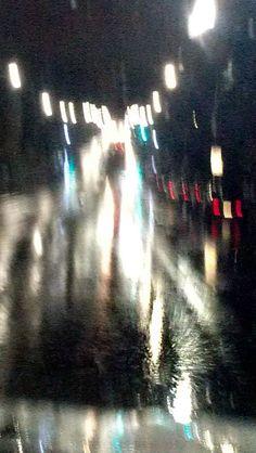 The red one, rainy street, running