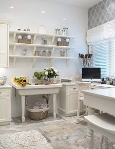 This is an ASID-MN first place award winning office, craft and laundry room, so you know it's good! :-)    The  flooring is versaille pattern travertine, sink is similar to Kohler Harborview.