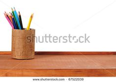 Color pencils on desk. Isolated - stock photo