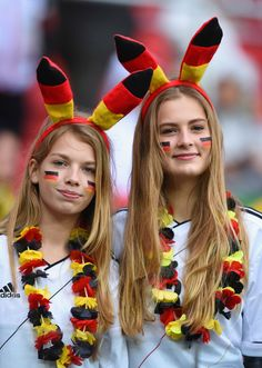 Germany Edges Algeria 2-1 To Reach World Cup Quarterfinals - Germany fans show their colours ahead of the 2014 FIFA World Cup Brazil Round of 16 match between Germany and Algeria at Estadio Beira-Rio on June 30, 2014 in Porto Alegre, Brazil. (Photo by Matthias Hangst/Getty Images)