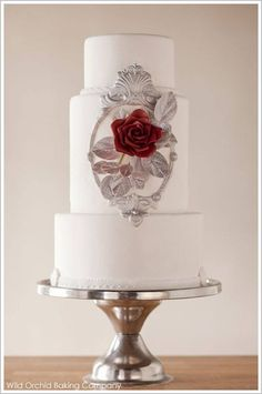 Snow white wedding cake with red rose